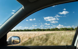 View from car window on wheat field Royalty Free Stock Images