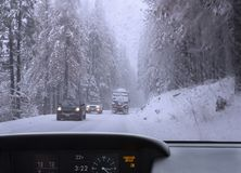 Driving in snowfall. Royalty Free Stock Photos