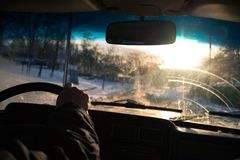 View from car window in winter snowy evening. Concept travel. View from car window in winter snowy evening. Concept travel Royalty Free Stock Image