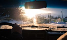 View from car window in winter snowy evening. Concept travel. View from car window in winter snowy evening. Concept travel Stock Image
