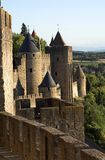 View at Carcassonne castle and surroundings. Carcassonne castle viewed from it's wall in a sunny summer day. The sky is blue, the foliage in surroundings is Royalty Free Stock Photography