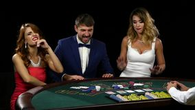View the cards man takes all the won chips stock footage