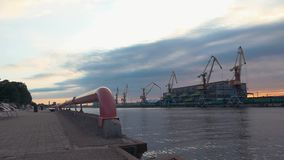 View of cargo port at seafront. River. Cranes. Containers. Summer evening. stock footage
