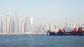 View of cargo ship in Dubai. Stock. Tanker in the waters near Dubai. Water transport concept.  stock video footage