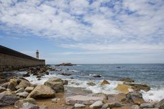 View from Carneiro beach in Porto to pier and lighthouse Felgueiras. Visit Portugal and travel concept stock photos