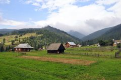 Carpathian Mountains and forest, rural houses Royalty Free Stock Photos
