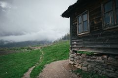 A View on the carpathian pinewood house. stock photography