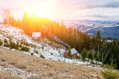 View on the carpathian pinewood houses. A View on the carpathian pinewood houses Royalty Free Stock Images