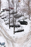View of cars covered with snow on parking Royalty Free Stock Photo
