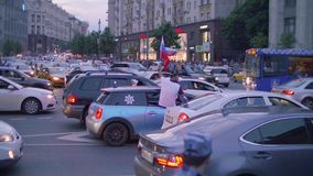 View of cars on road with Russian flags and fans aftter Russia won match Russia vs Spain. View of cars on road with Russian flags and fans aftter Russia vs Spain stock video