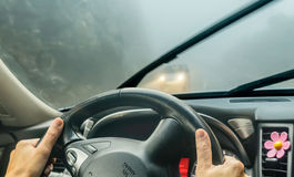 View through the cars windshield  in the winter fog on the road Stock Photos