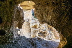 View through carved cave window. Church of St. John the Baptist in Cavusin. Cappadocia. Turkey Royalty Free Stock Image