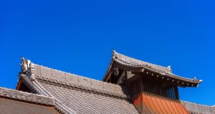 View of the carved wooden roof of the building, Kyoto, Japan. Copy space for text. Isolated on blue background. royalty free stock images
