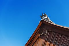 View of the carved wooden roof of the building, Kyoto, Japan. Copy space for text. Isolated on blue background. stock photo