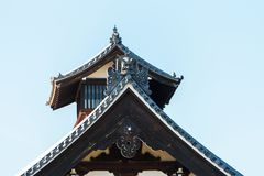 View of the carved wooden roof of the building, Kyoto, Japan. Copy space for text. royalty free stock photo