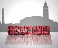 View of Casablanca. Word Casablanca with national flag of Morocco near skyline silhouette Royalty Free Stock Images