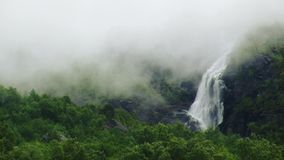 View of cascade waterfall in green forest among volcano. Summer day. Smoke. Nature. Nobody. stock video footage