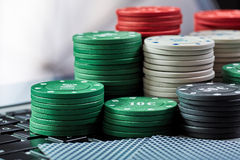 View of casino chips, cards on laptop to play online. stock photography