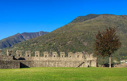 View from the Castelgrande fortress in Bellinzona, Switzerland. Wall of the medieval fortress Castelgrande in Bellinzona, Switzerland, mountains in the Stock Image
