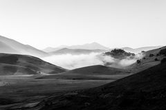 View of Castelluccio di Norcia Umbria at dawn, with mist, big stock photography