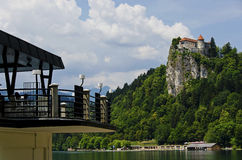 View of the castle of Bled from a restaurant across the lake Stock Image