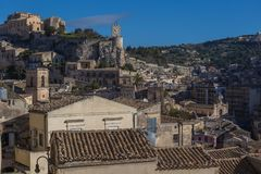 View of the castle and clock tower in the centre of Modica. In Sicily, Italy Stock Photos