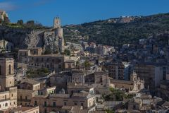 View of the castle and clock tower in the centre of Modica. Sicily, Italy Stock Photo