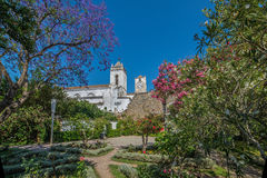 View from castle garden to the historic Church of Santa Maria do Castelo- in the city Tavira, Algarve, Portugal Royalty Free Stock Image
