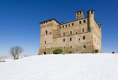View of the Castle of Grinzane Cavour in winter with snow stock photography