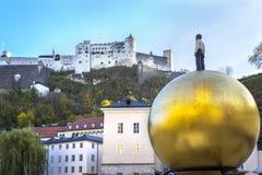 View of Fortress Hohensalzburg and man figure on big golden ball, Salzburg, Salzburger Land, Austria Stock Images