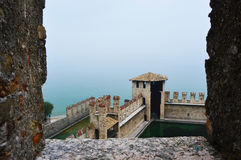 View from the castle of Lake Garda with fog, Sirmione, Italy Royalty Free Stock Photography