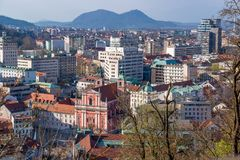 Ljubljana from above. View from the castle of Ljubljana with the Pink Church and distant Alps, Slovenia royalty free stock photos