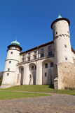 View on castle Nowy Wisnicz in Poland on a background of blue sk Stock Photo