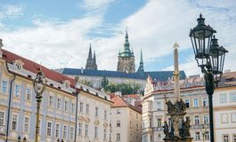 View of the castle in Prague. From the Lesser Town with a plague column in the foreground stock photos