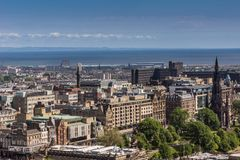 View from Castle on Princess Street, Edinburgh, Scotland. Edinburgh, Scotland, UK - June 14, 2012: Wide view from top of castle towards North Sea inlet and stock photo