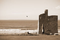View of castle and rippled sandy beach Royalty Free Stock Photography
