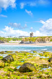 View of castle and rippled sandy beach Royalty Free Stock Images