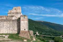 View of castle Rocca Maggiore, medieval fortress dominating th. E city Assisi world heritage of Unesco. Umbria, Italy stock image