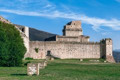 View of castle Rocca Maggiore, medieval fortress dominating th. E city Assisi world heritage of Unesco. Umbria, Italy stock photography