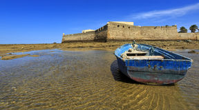 View of the castle of Santa Catalina with aged ship on forefront, Cadiz, Andalusia, Spain. Stock Photo
