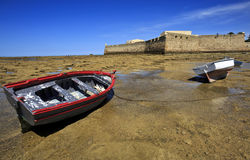 View of the castle of Santa Catalina with aged ship on forefront, Cadiz, Andalusia, Spain. Stock Photography