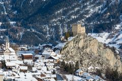 View on the castle in the small village Ladis in ski resort Serf. Aus Fiss Ladis in Austria with snowy mountains Stock Photo