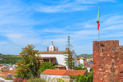 View of castle tower with Portuguese flag Royalty Free Stock Photos