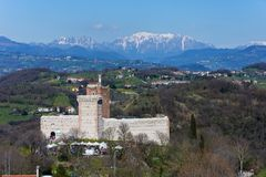 View of the `Castle of the Villa` also known as Romeo`s Castle in Montecchio Maggiore. With the background of the snow-capped Alps, Veneto Stock Image