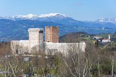 View of the `Castle of the Villa` also known as Romeo`s Castle in Montecchio Maggiore. With the background of the snow-capped Alps, Veneto Royalty Free Stock Photo