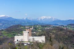 View of the `Castle of the Villa` also known as Romeo`s Castle in Montecchio Maggiore. With the background of the snow-capped Alps, Veneto Stock Images