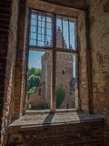 View through castle window. Peeking through the window of a castle ruin Stock Images