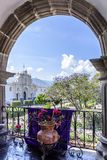 View of cathedral & central park from city hall terrace, Antigua, Guatemala. Antigua, Guatemala - April 10, 2019: View of San José cathedral & central park royalty free stock photography