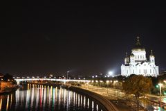 View of the Cathedral of Christ the Savior and the Bolshoy Kamenny Bridge in Moscow. In the autumn, at night stock images