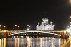 View of the Cathedral of Christ the Savior and the Bolshoy Kamenny Bridge in Moscow. In the autumn, at night royalty free stock image